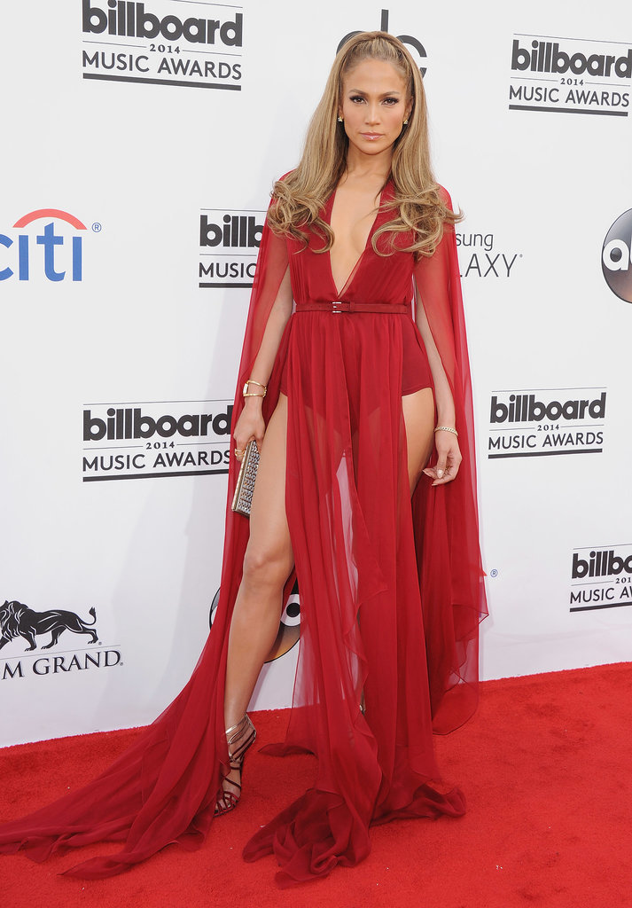 At the 2014 Billboard Music Awards, Lopez turned up the heat in a skin-hugging bodysuit and sheer-paneled Donna Karan creation.