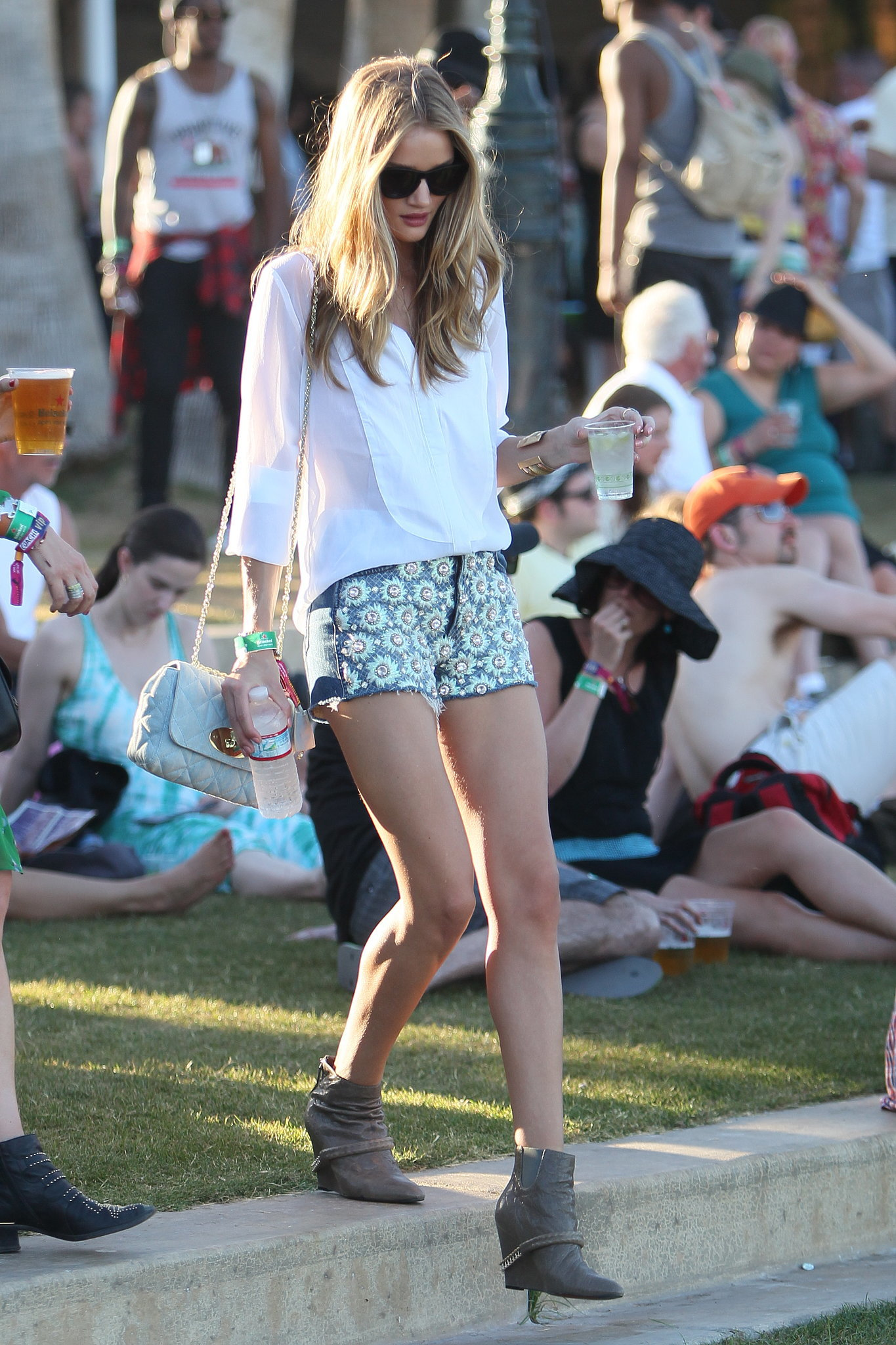 Rosie Huntington-Whiteley made good use of her daisy-print denim with a breezy white button-down and ankle boots at Coachella.