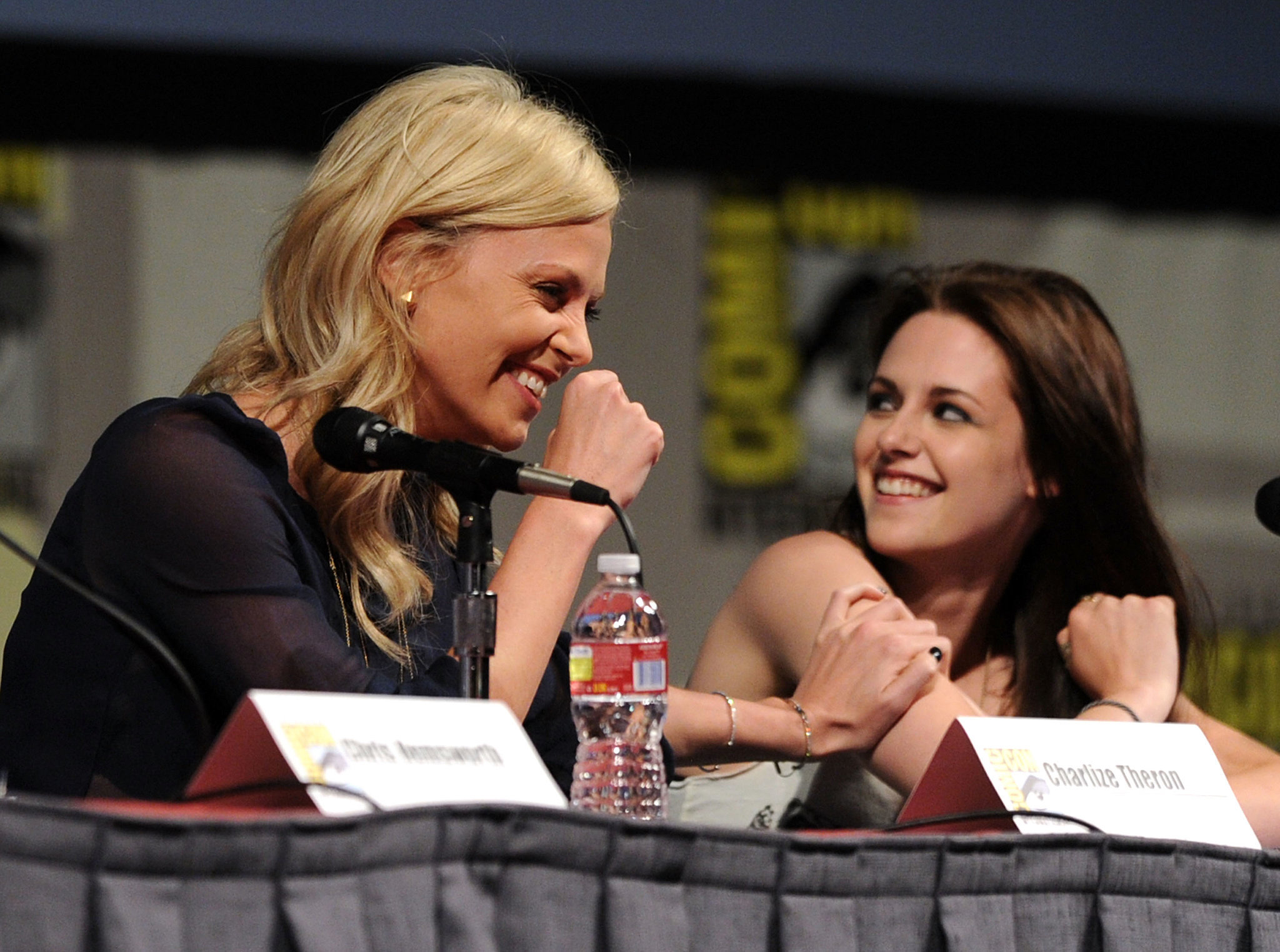 Charlize Theron and Kristen Stewart shared a laugh during the Snow White and the Huntsman panel discussion in 2011.
