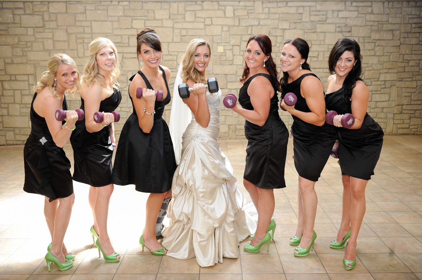Real bridesmaids lift! Brittany and Derrick got the bridal party in the spirit of the celebration with fun and sweet photos.