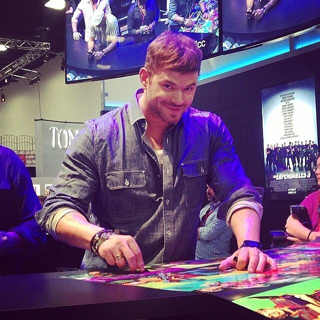 Far from a newbie at Comic-Con, Kellan Lutz looked right at home while signing The Expendables 3 posters.  Source: Instagram user kellanlutz