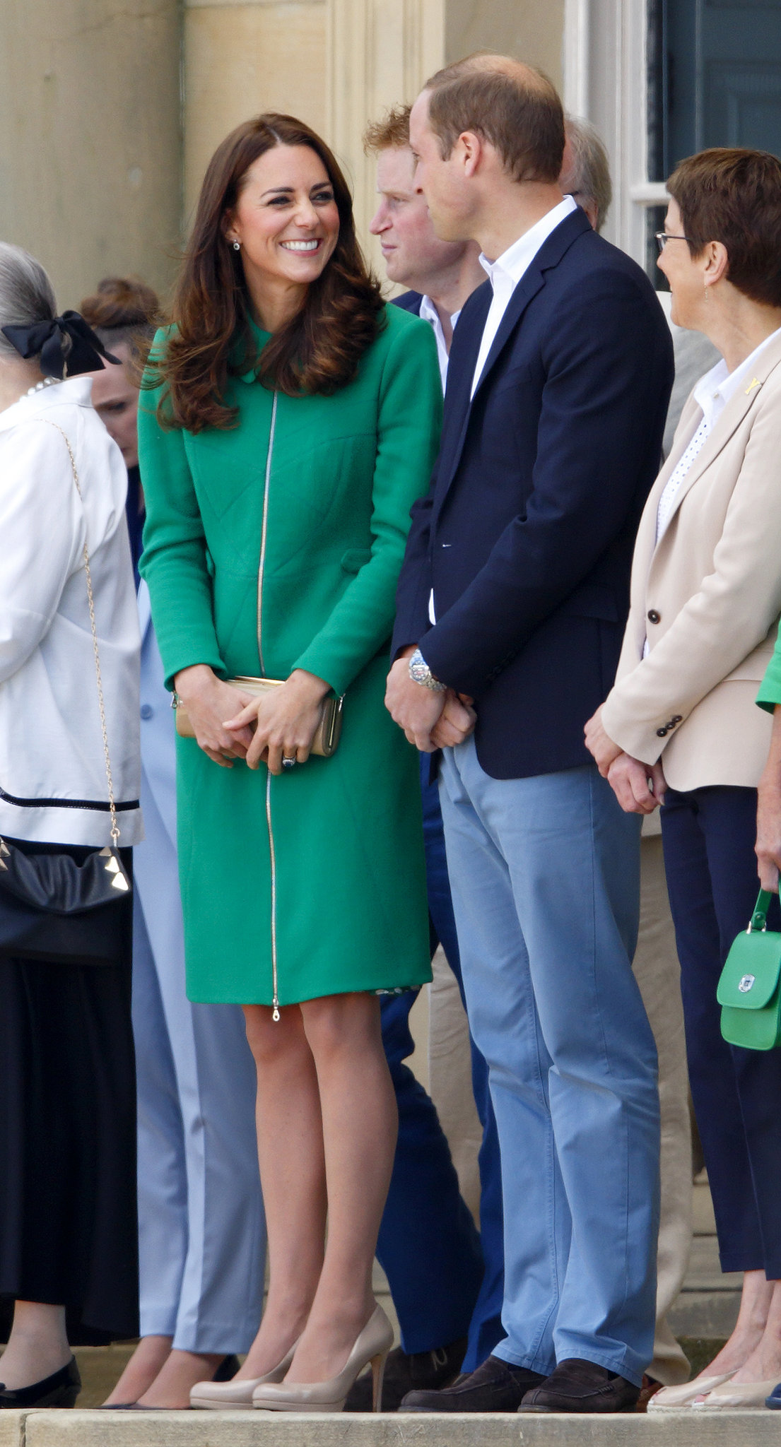 Kate smiled at William while attending the Tour De France in the Summer of 2014.