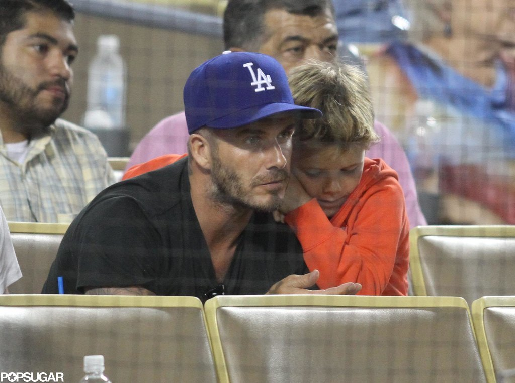 David snuggled with Romeo while watching a Dodgers game.