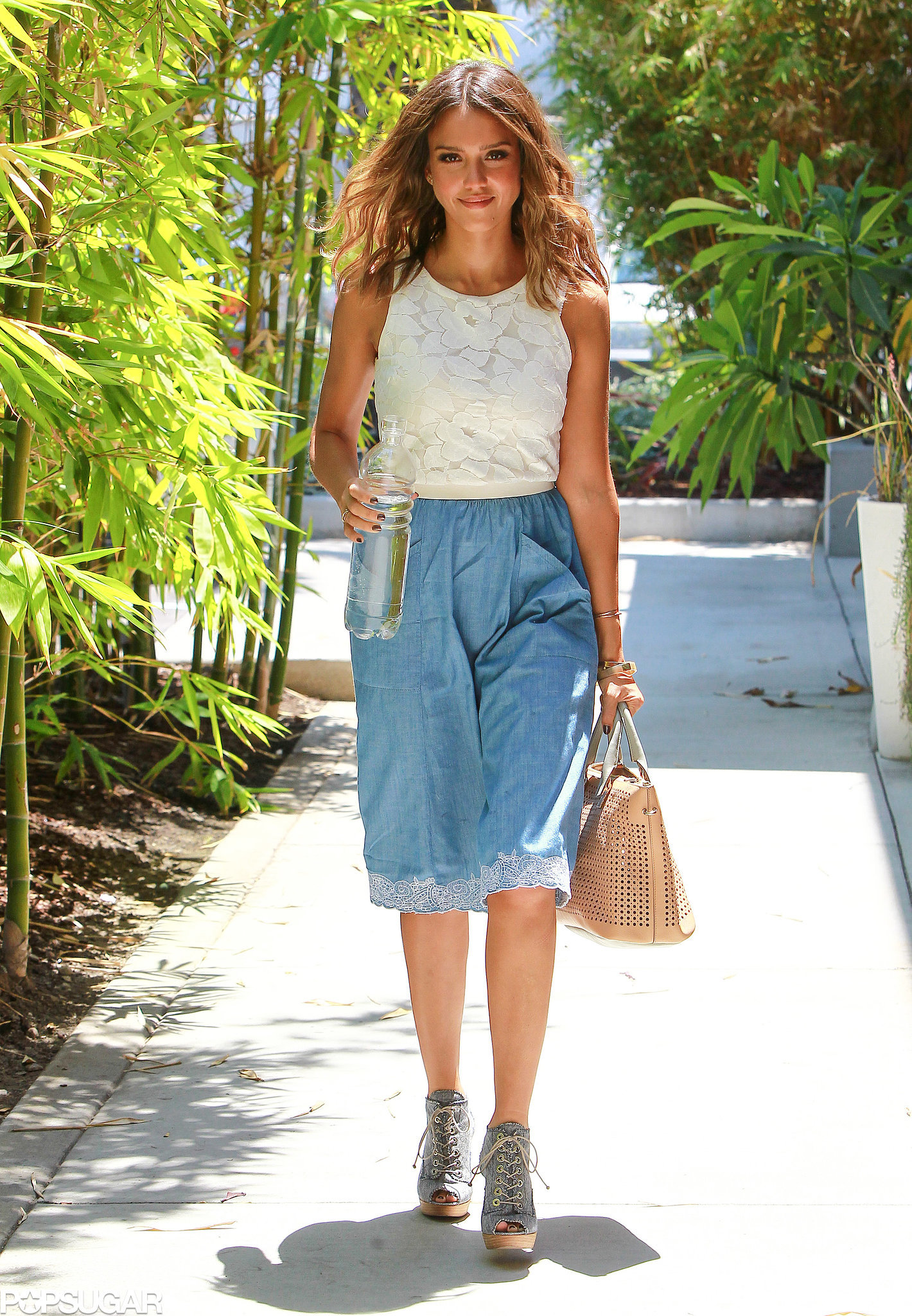 Jessica Alba showed off her flawless tan in LA on Friday.