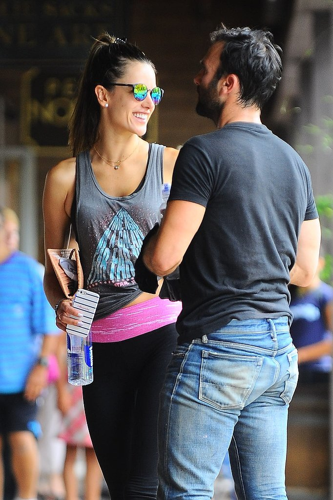 Alessandra Ambrosio had a big smile next to her husband Jamie Mazur after scor
