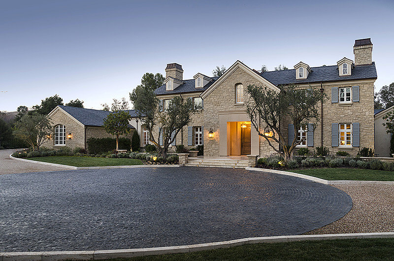 The front of the home doesn't betray its large size, nor its resort-style backyard.  Source: Zillow