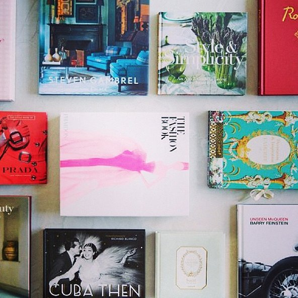 You don't have to be hosting a book club to get people talking about your favorite reads. Lay out inspirational books on the table so your guests can easily flip through them. Source: Instagram user withoutlipstick