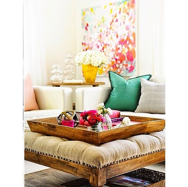 For a coffee table that does double-duty, ditch a traditional piece for a bench or plush seat instead. Top with a decorative tray that is easy to remove when the couch is full.  Source: Instagram user innerdecor