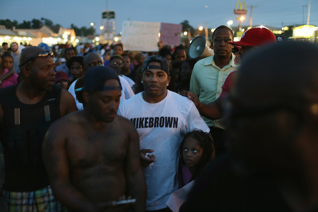 Rapper Nelly walked with demonstrators during a peaceful protest in Ferguson.