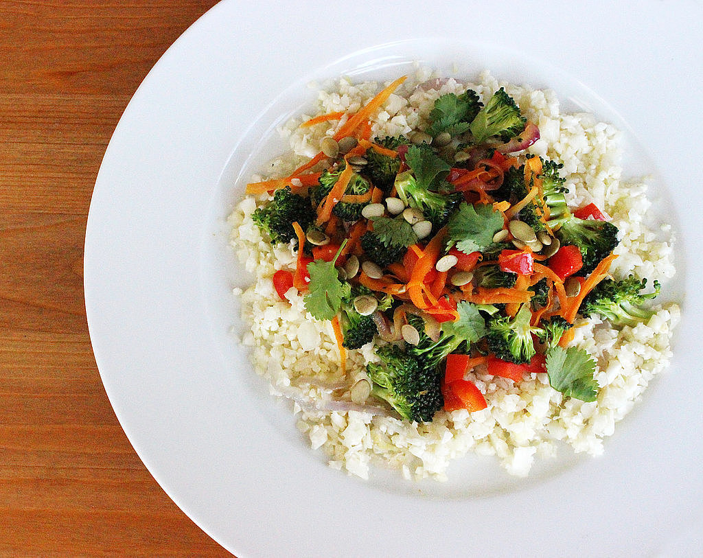 This veggie-filled stir-fry swaps out rice for cauliflower, making it ...