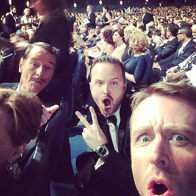 """Chris Hardwick had """"REALLY GOOD SEATS"""" at the 2014 Emmys, making this this selfie with Bryan Cranston and Aaron Paul possible."""