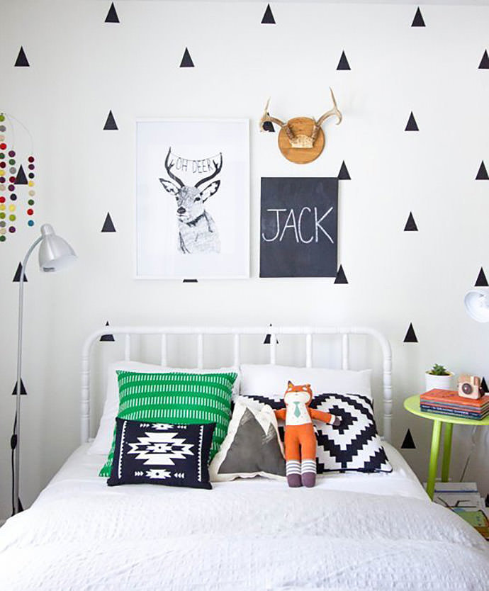 Chalkboards make great name wall decorations, too: Last but not least, if you prefer to keep things simple, why not just write your little one's name on a chalkboard like Ginny Chase? This wall decoration stands out so well in the modern, graphic black and white space she designed for her son, and her idea can be customized to the style of any room. Chalkboard paints exist in various colors, and you could even try using one board per letter.