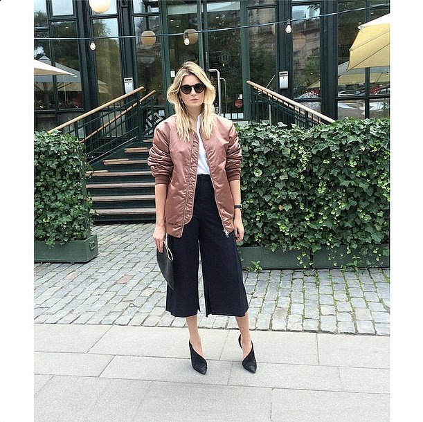 A striking, somewhat flashy bomber is going to be the coat of Fall, lending your outfits a sporty touch. Throw it over your tailored, more conservative pieces for the ultimate cool-girl look. Source: Instagram user camtyox
