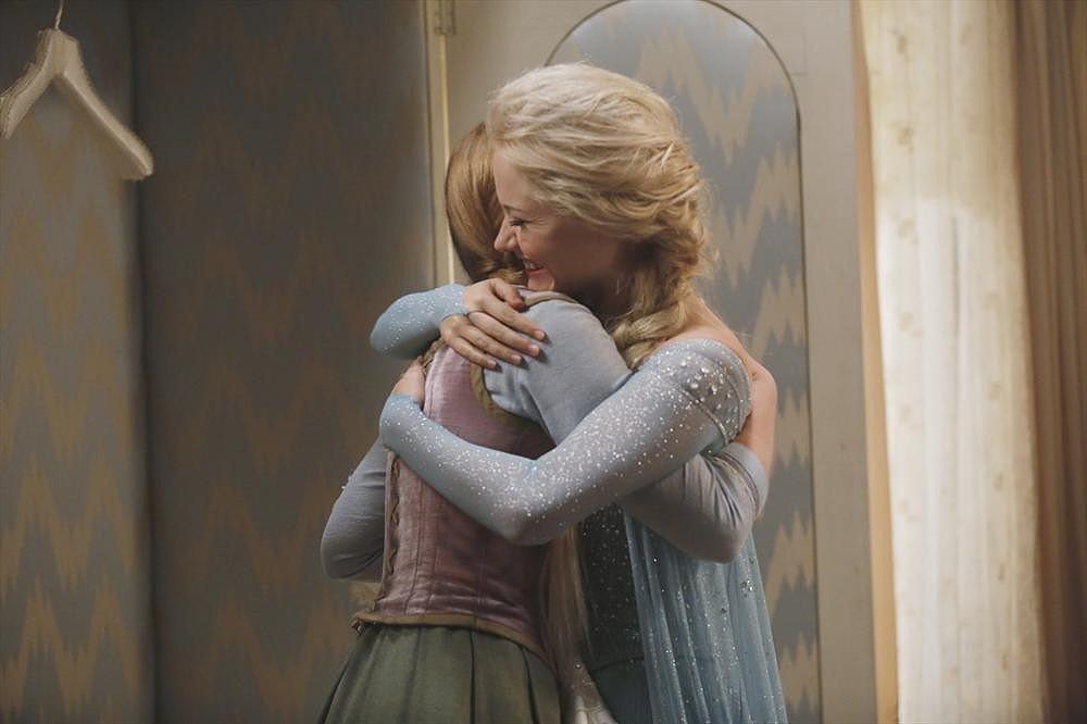 The sisters hug.