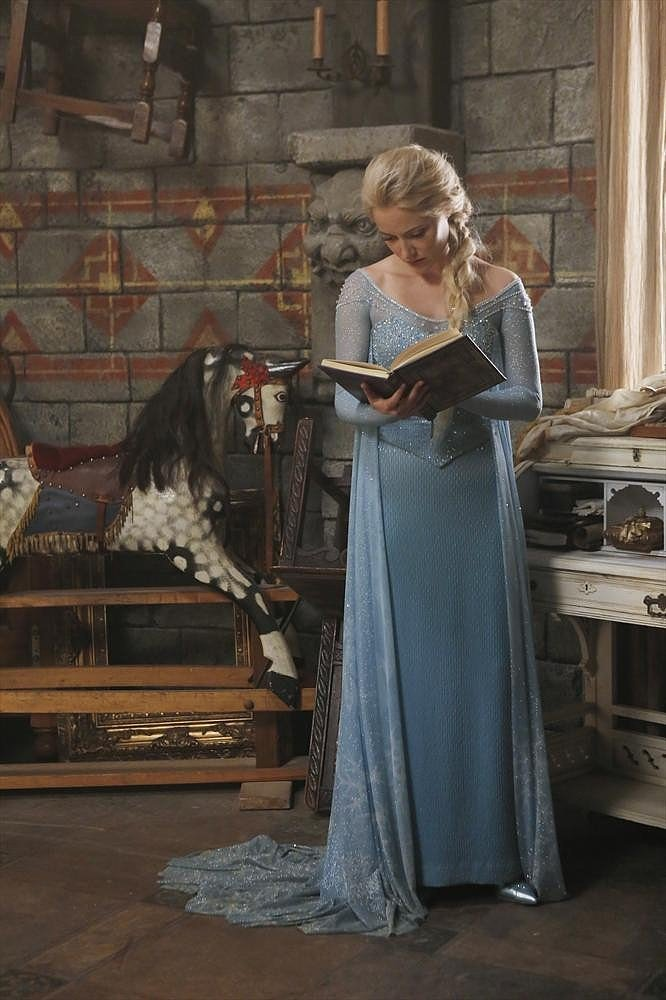 Elsa reads a book.