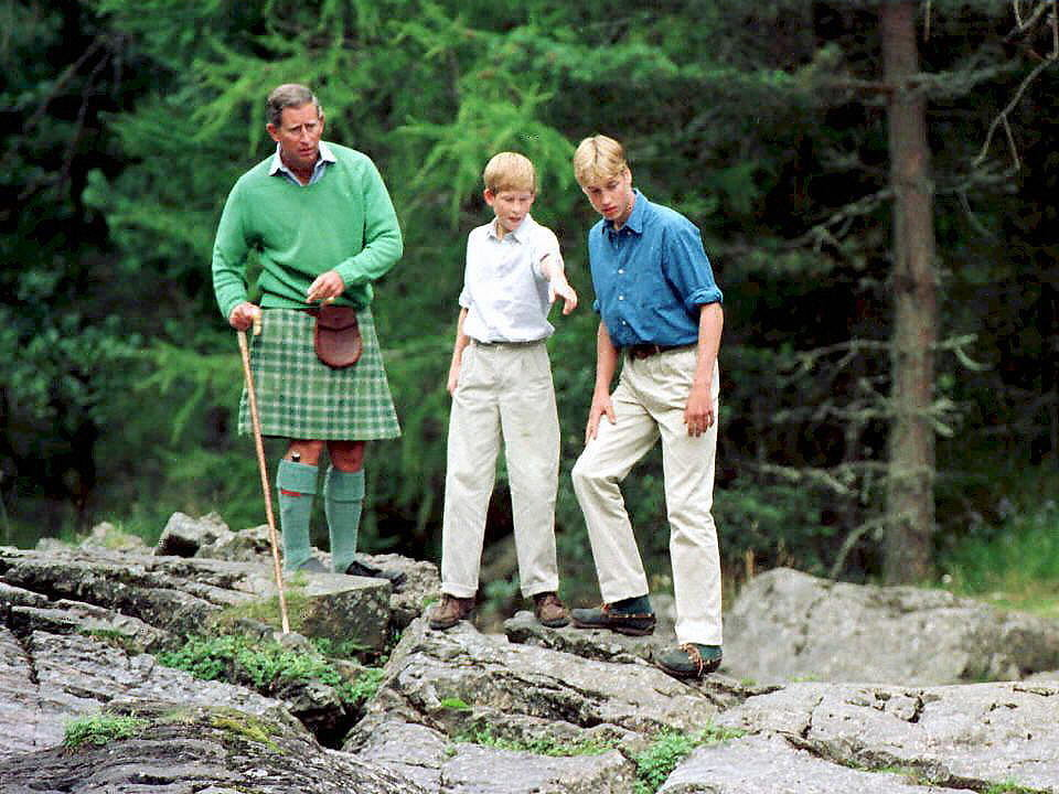 Harry took a hike with William and Charles during a Summer vacation at Balmoral Castle in 1997.