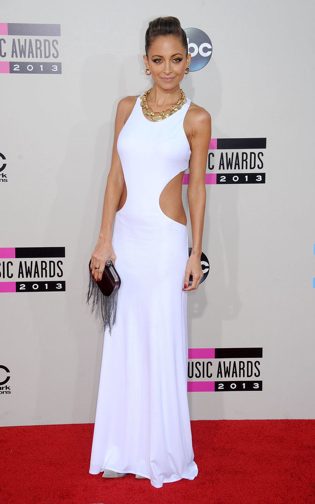 Nicole looked gorgeous in a white cutout gown at the American Music Awards in November 2013.
