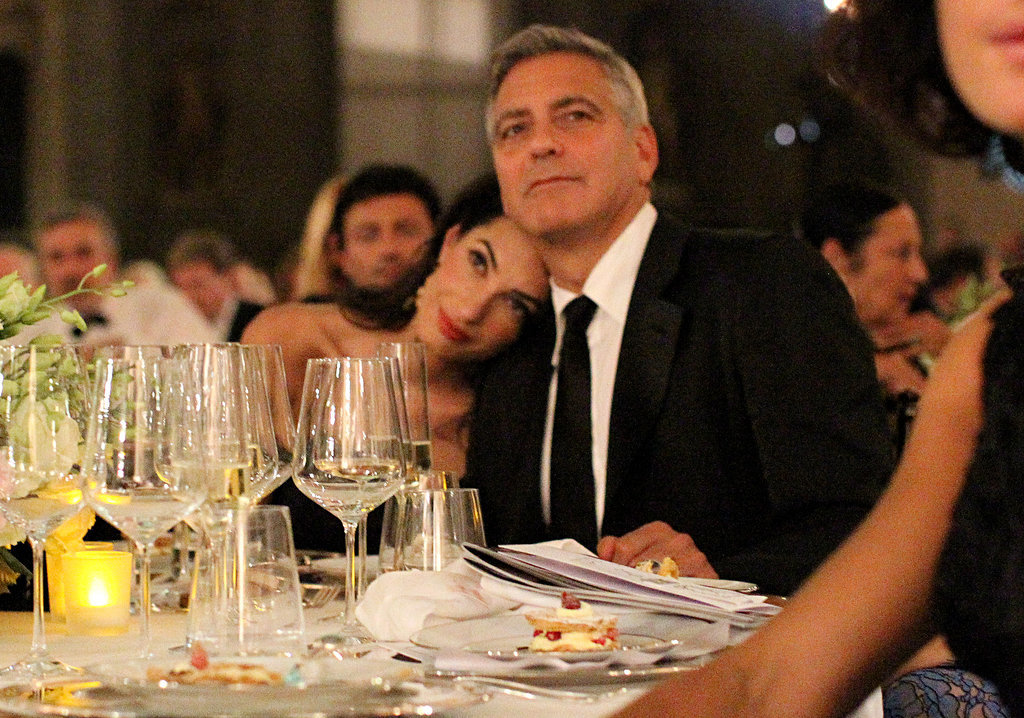 Amal rested her head on George's shoulder while at a Celebrity Fight Night in Italy in September 2014.