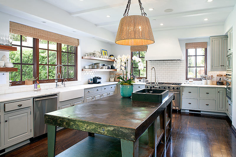 The forest-green kitchen island gives the space a pop of color. We wish we had that much counter space! Source: David Offer Fine Homes