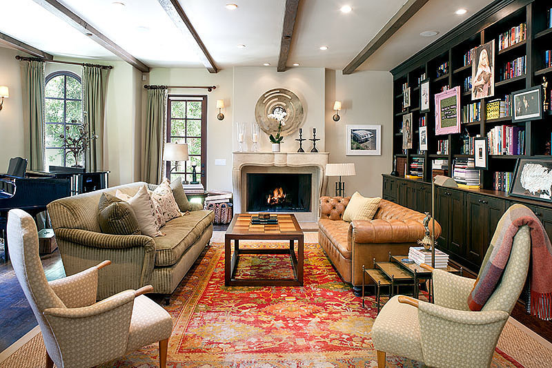 A collection of mixed and matched furniture gives the living room a comfortable vibe. The celeb's massive book collection is easy on the eyes as well. Source: David Offer Fine Homes