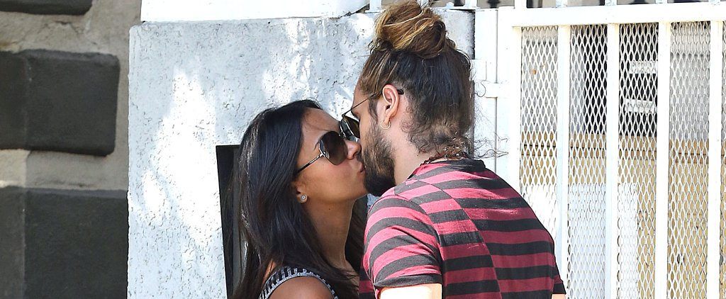 Pregnant Zoe Saldana Seals Her Saturday With a Romantic Kiss