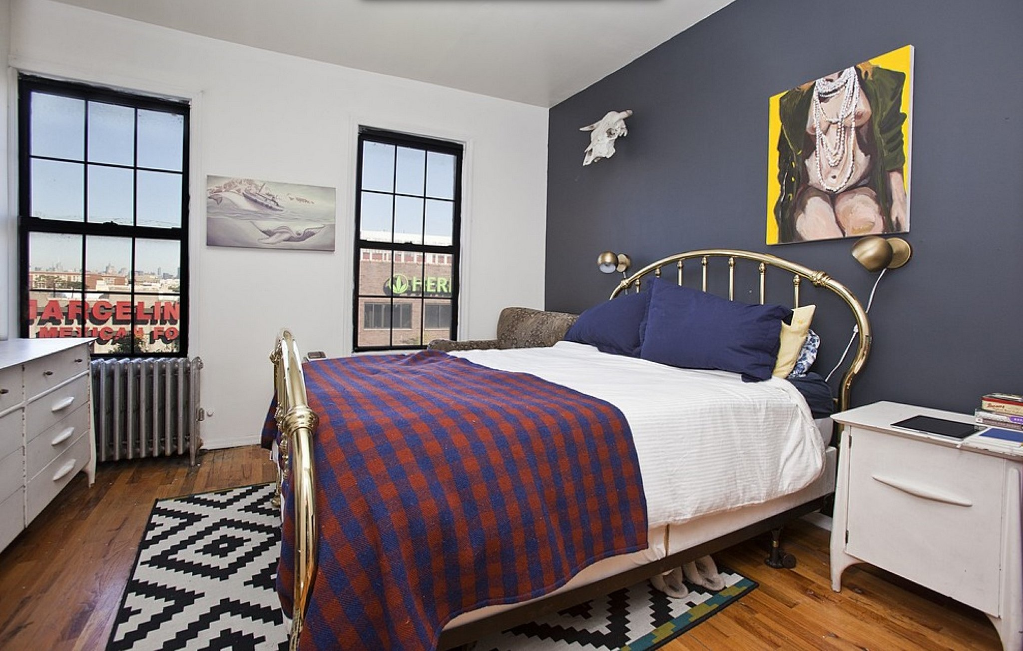 A Navy Blue Accent Wall Is The Focal Point Of This Bedroom Inside This Girls Star 39 S Brooklyn