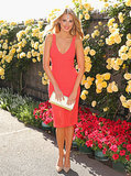 Laura Dundovic at 2014 Melbourne Cup Wearing an Orange Dress