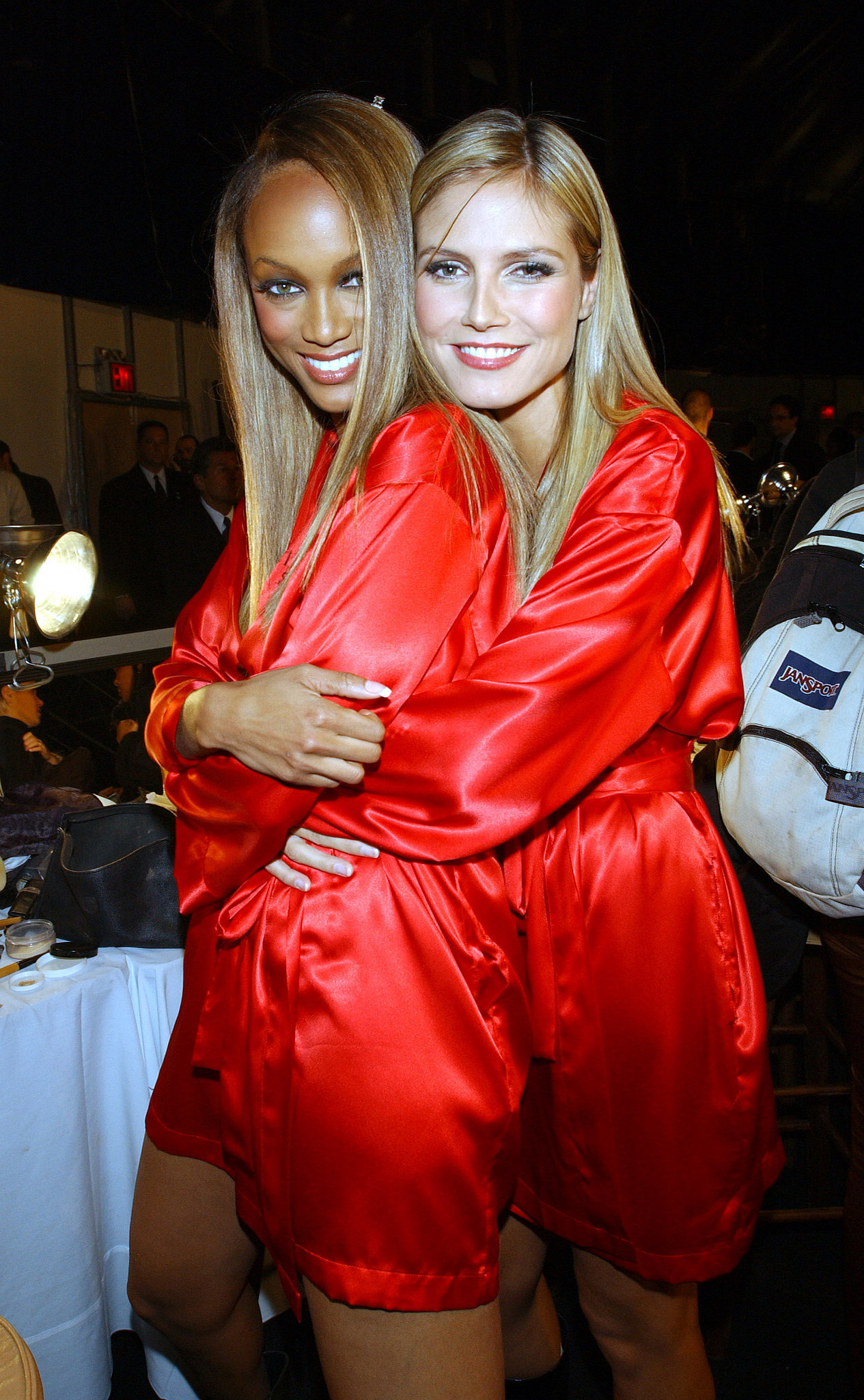 Tyra and Heidi hugged it out in their red robes backstage in 2001.