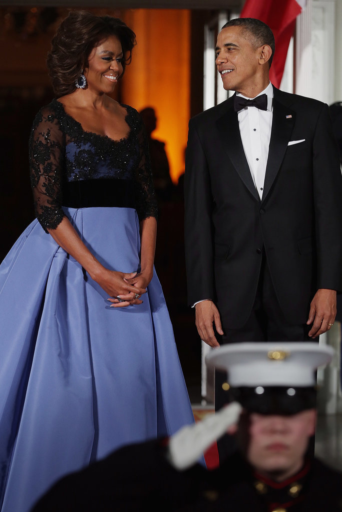 First Lady Michelle Obama stunned alongside President Obama, who also looked dapper as the pair welcomed French President Francois Hollande in February.