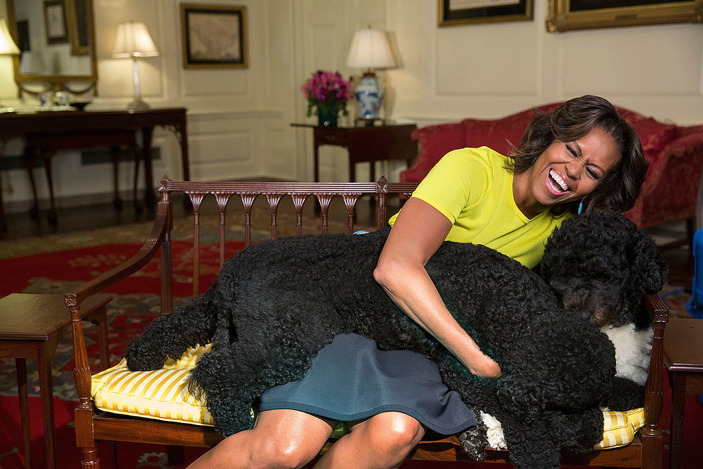 The first lady hugged her dogs for a cute snap in April.
