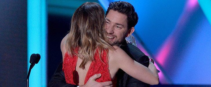 Watch John Krasinski Sneak on Stage to Hug Emily Blunt