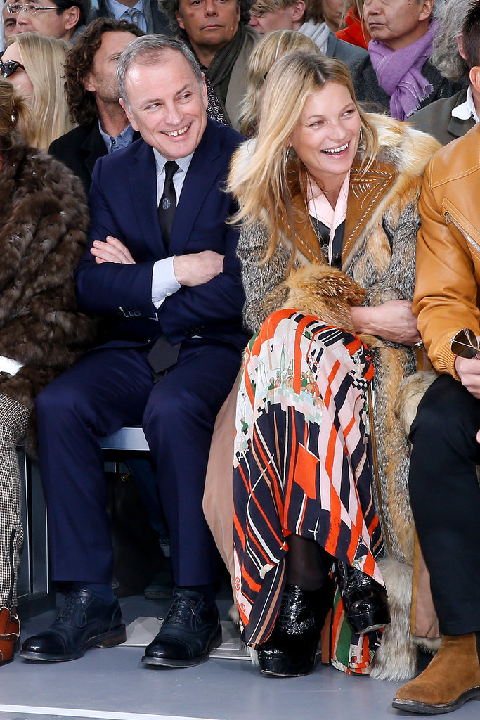 Kate Moss joined Louis Vuitton CEO Michael Burke in the front row at the company's Paris Fashion Week show on Thursday.