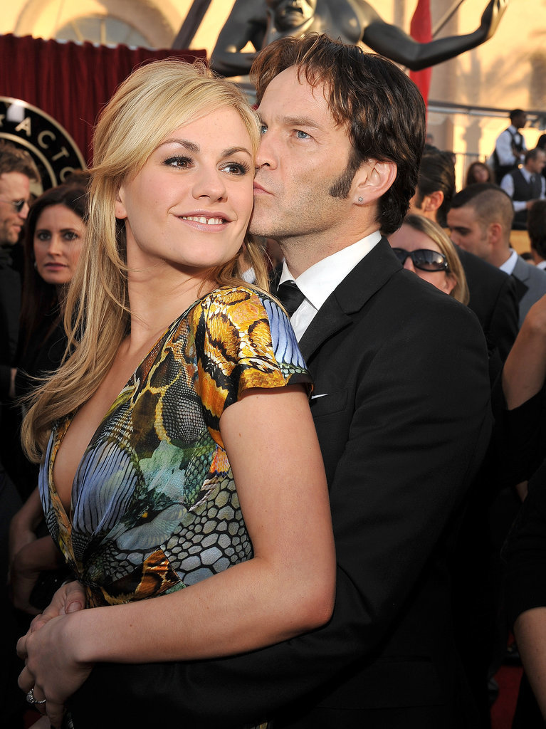 Real-life couple and True Blood costars Anna Paquin and Stephen Moyer shared a kiss before the 2010 show.