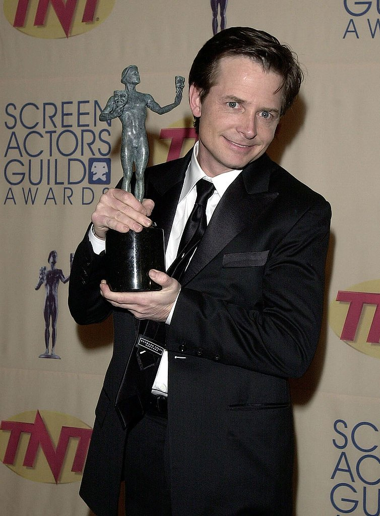 Michael J. Fox posed with his Spin City statue in 2000.