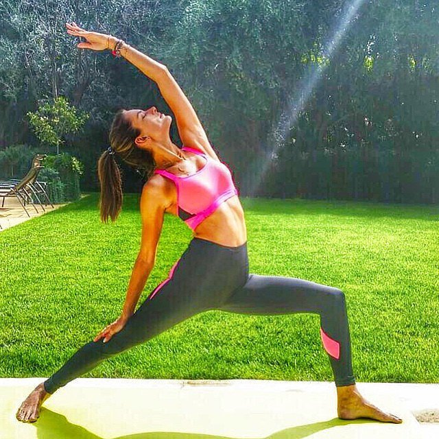 Alessandra Ambrosio reminded everyone how she stays in shape for Victoria's Secret by showing off some yoga poses.