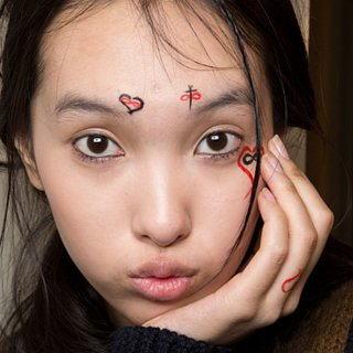 Milan's Models Flaunt Painted Lashes and Doodled Designs