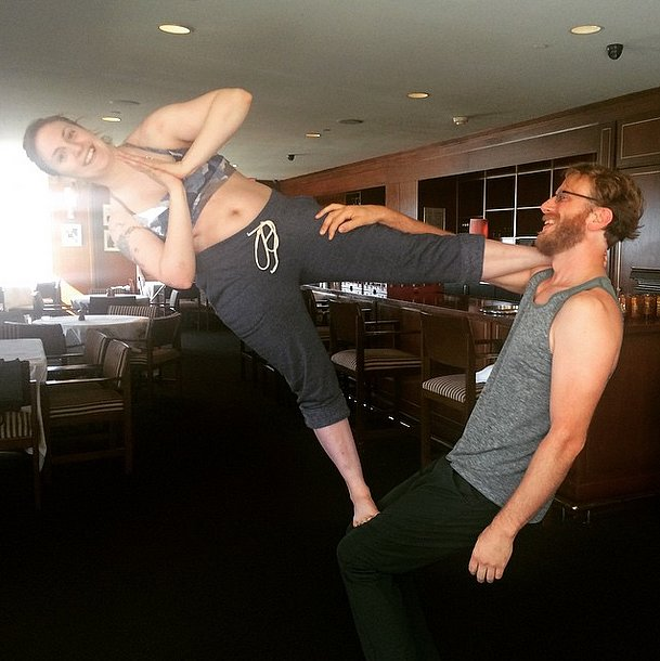 Lena Dunham was smiling sideways during an AcroYoga lesson.