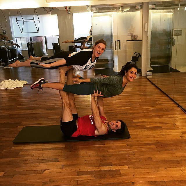 Lena Dunham is getting a little Acro Yoga action on!