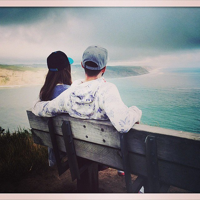 Justin and Jessica admired the view from a park bench during a 2015 trip.