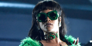 Rihanna Rocks 2015 iHeartRadio Music Awards In Versace Green Fur Coat & Thigh-High Boots