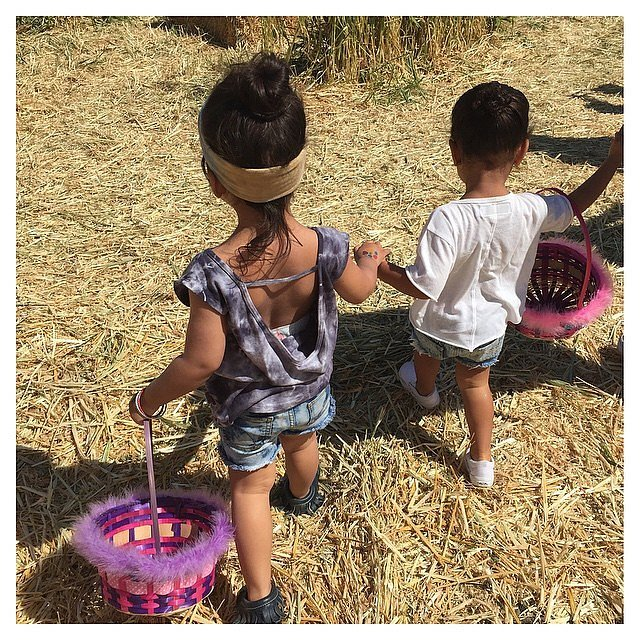 North and her pal Ryan held hands while hunting for eggs.