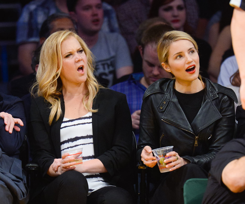Amy Schumer and Dianna Agron were both perplexed by a play at an LA Lakers game in March 2014.