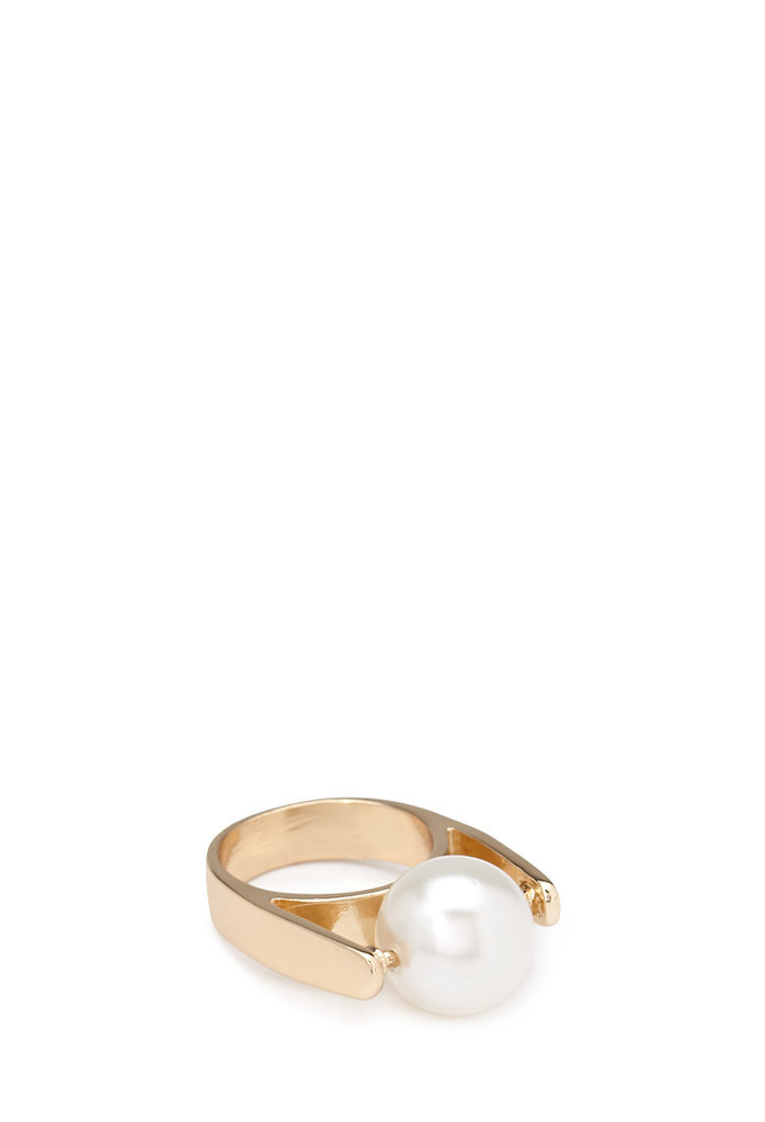 Mom will think you spent a fortune on this pretty cocktail ring — but you'll still have plenty left over to treat her to brunch.  Forever 21 Faux Pearl Cutout Ring ($4)
