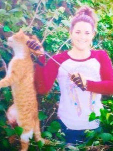 Texas Vet Posts Shocking Facebook Photo of Feral Cat She Shot as Her 'First Bow Kill'
