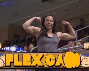 Watch This Girl Totally Dominate a Guy in a Flexing Challenge