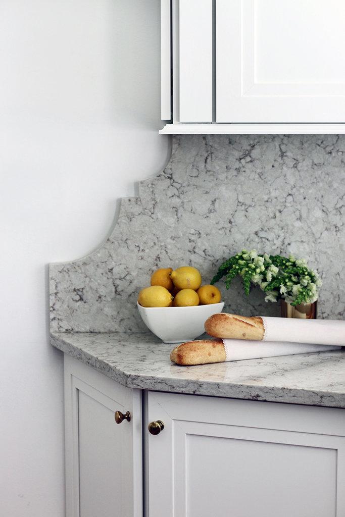 we love the edges of the stone backsplash