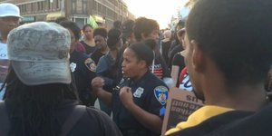 Baltimore Police Officer Calls For Community And Cops To Come Together, Tells Demonstrators: 'I'm Here For You'