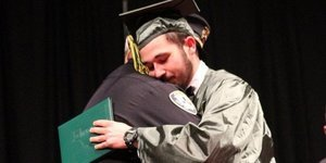 Police Officer Who Told A Teen That His Parents Had Been Killed Attends His Graduation