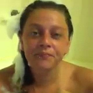 Girl Signs in a Bathtub | Video