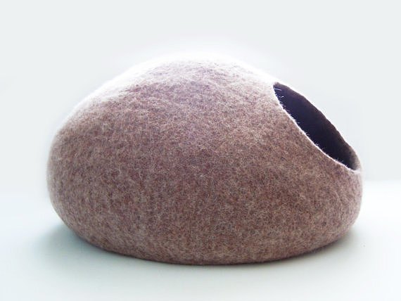 This gray felted cat cave ($55) would make the perfect little hideaway for your kitty.